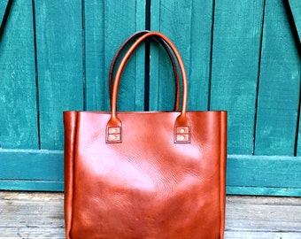 Hand sewn, rolled handle, leather tote bag