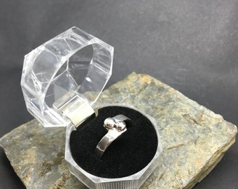 Handmade sterling silver crossover ring with two solid silver balls