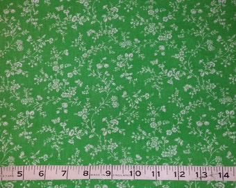 White flowered polycotton on green background