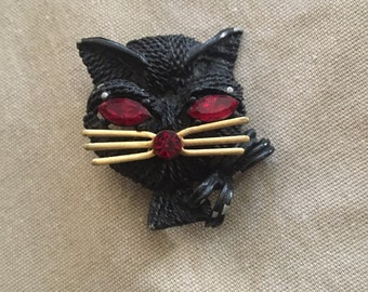 Vintage black metal and red rhinestone cat face brooch pin kitty