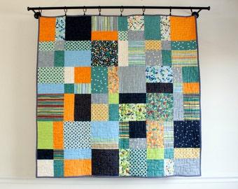 modern patchwork quilt // baby boy quilt in blue green grey and orange