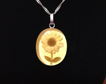 Beautiful Silver necklace with a real flower pendant