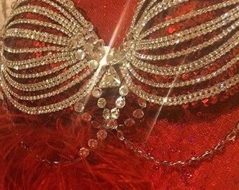 """The  """"Follies"""" showgirl rhinestone bra in red.  Austrian Crystal handset and welded on red sequin bra"""