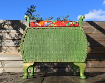 Upcycled mid-century Lloyd Loom-style storage seat with red velvet lovebirds fabric.