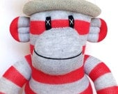 Red and Grey Striped Sock Monkey with stars pom pom hat