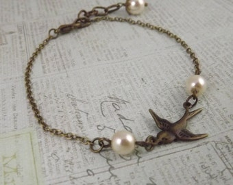 Delicate Ivory Pearl and Brass Swallow Bracelet
