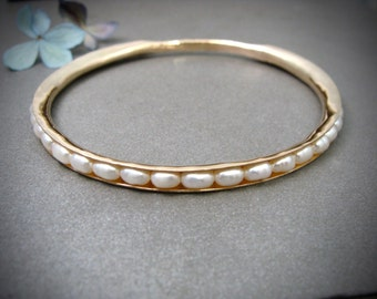golden pearl skinny bangle .. 14k gold filled
