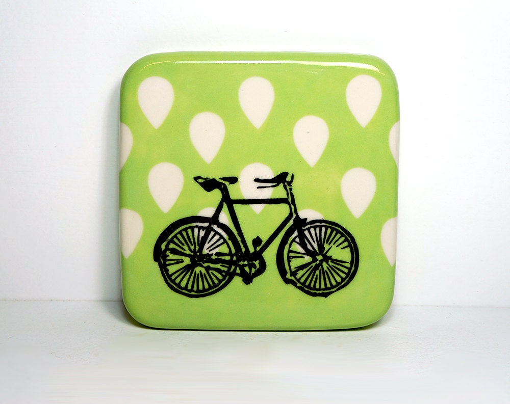 tile with a dusty road bike on a tinda green background with reverse droplets of white. Ready to ship.