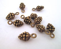 12 brass plated pine cone charms