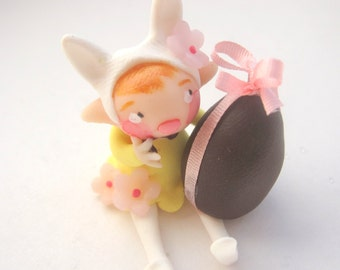 Little bunny with easter egg
