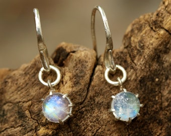 Round cabochon moonstone  earrings in silver prong setting with sterling silver hooks