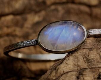 Moonstone silver bangle bracelet with bezel set gemstone on square solid silver bangle