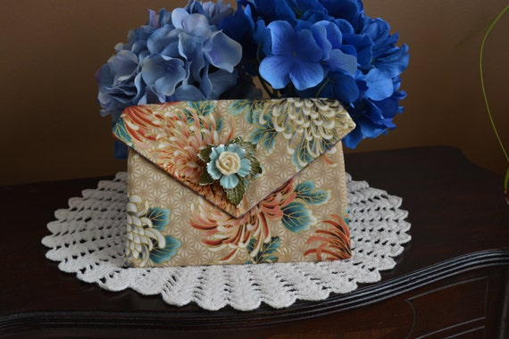 One of a kind corded pocket with brooch
