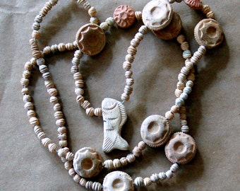 Terra Cotta ceramic beads from Mexico - 1 long strand with  Fish