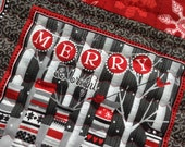 Winter table topper with riendeers and snowflakes in red and black