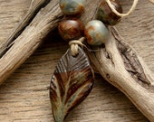 ORGANIC LEAF SET - Blue with hints of Chocolate Brown Pendant with Four Round Beads - Handmade Ceramic Pendant Set