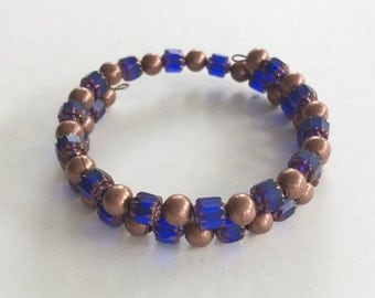 Sapphire cathedral bead memory wire bracelet - copper accents
