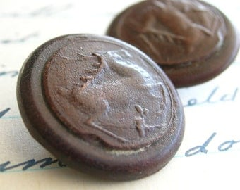 Two Matching Leather Buttons Embossed with Stylized Deer or Elk