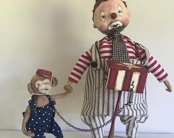Organ grinder clown with monkey