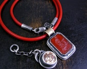 Sterling silver topaz and carnelian pendants with leather choker
