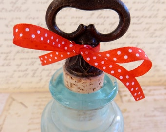 Bronze Wine Bottle Stopper With Red Ribbon
