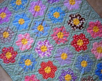 Grandmas Flower Garden Hand Pieced Hexagon Quilt from Quilts by Elena