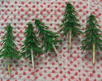 five cute little plastic trees