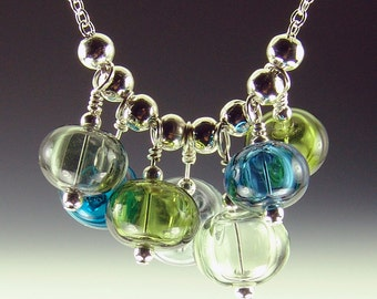 Marina-Hollow Lampwork Bead necklace, 7 beads on 18 inch silver plated chain