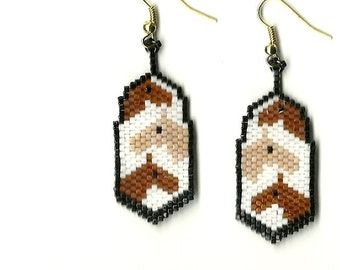 A pair of hand beaded tiny horse head 's on a feather shaped dangle earrings.