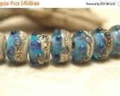 ON SALE 30% OFF Handmade Glass Lampwork Bead Set - Seven Transparent Blue Seashell Rondelle Beads 10407101