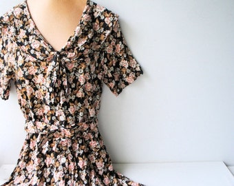 Boho vintage 90s  rayon , grunge,mini romper dress with tiny beige -pink roses print on the black field. Made by Caren Desiree and Co. S-z 6