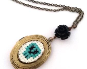 ON SALE Teal Green Skull Cross stitch Locket necklace- xstitch fiber art wearable art  crossstitch day of the dead