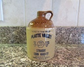 Small stoneware Whiskey jug- McCormick Platte Valley Straight Corn Whiskey- nice condition, clean and beautiful