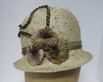 Neutral color knotted straw cloche with narrow brim