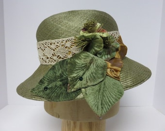 Sage green wide-brimmmed parasisal straw cloche.