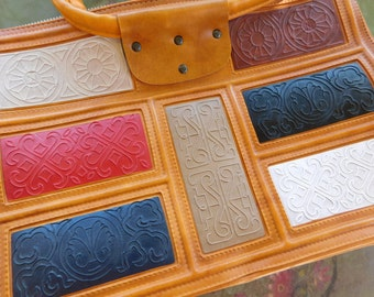 Vintage Handbag , Vinyl Leatherette Fashion Purse Embossed Designs Multicolored Inset Pieces Marked: TNL ( ? )
