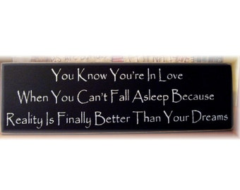 You know you're in love when you can't fall asleep because reality is finally better than your dreams wood sign