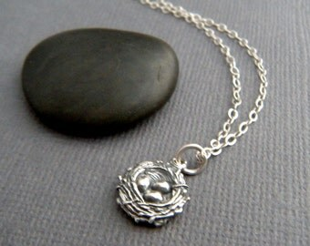 """tiny silver nest necklace. small sterling silver woodland pendant bird nest with 3 eggs. small simple jewelry. mother child charm. gift 3/8"""""""