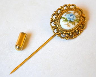 Vintage gold tone hat pin with blue rose cameo, scalloped edges