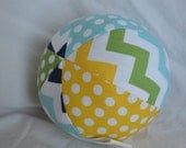 Chevron Jingle Ball Baby Toy in yellow, green, and blue