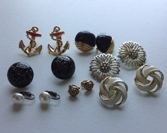 Seven pairs vintage clip on earrings