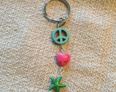 Pink, teal, and green, peace, love, and starfish keychain
