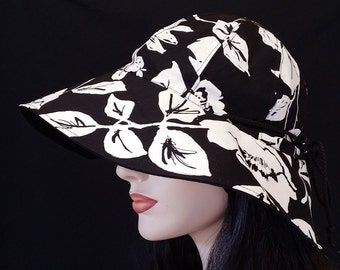Reversible Wide Brim Sun Hat in black and white tropical print with adjust fit plus chinstrap for boating/convertibles/windy days