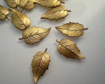 12 brass leaf charms, No. 9