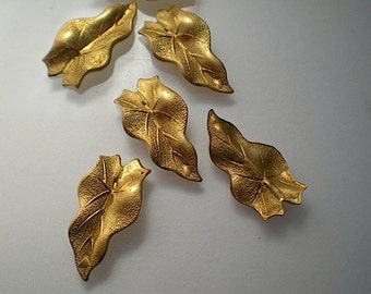 6 brass leaf charms, No. 8