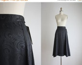 VACATION SALE. silky black midi skirt