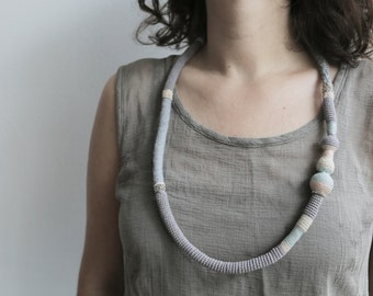 What the snake has eaten - Pale Grey Snake Tribal Necklace