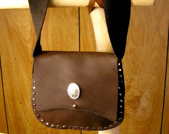 "Mountain Man oil tan leather Possibles bag, Brown oil tan leather with ball button, studs & concho, bag is 7"" x 5.5"" x 1.5"", 2"" wide strap"