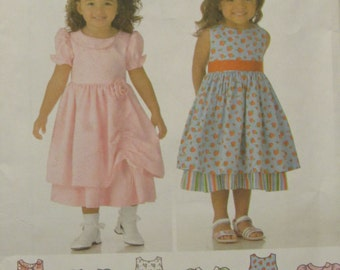 Simplicity 4246/Uncut Sewing Pattern/Girls Dress with Skirt and Trim Variations/Size 1/2 - 4/2006/Toddlers/Baby