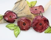 Handmade, Bright and shining flower and leaf polymer clay asymmetrical statement necklace
